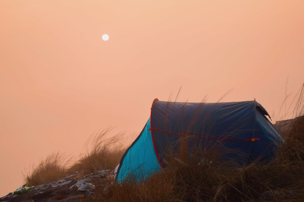Dark Blackout Tent against the backdrop of a misty sky that is heating up