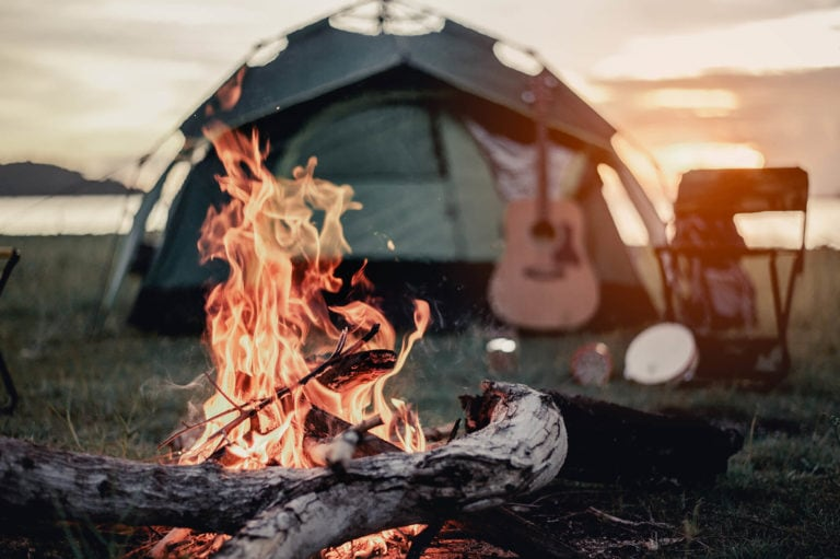 Easy setup tent in background campfire foreground