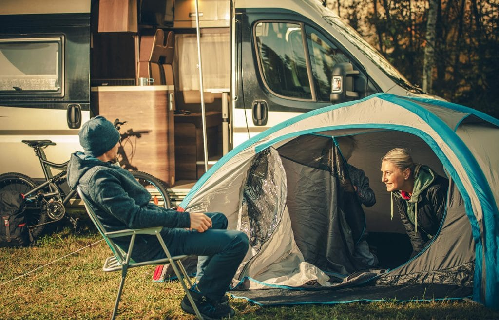 Family-camping-with-grey-blue-instant-tent-with-camper