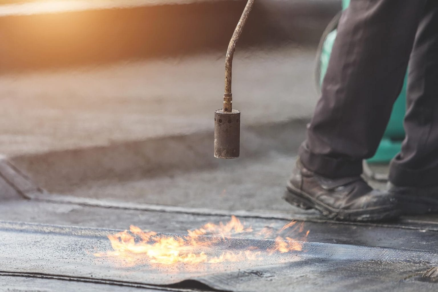 MAPP Gas versus propane worker uses gas to heat material outside