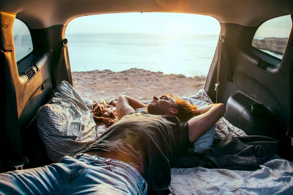 Man sleeps in car with boot fully up getting max air