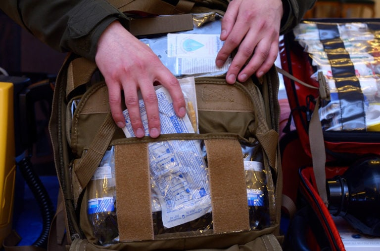 Medic packing backpack with supplies with lots of pockets