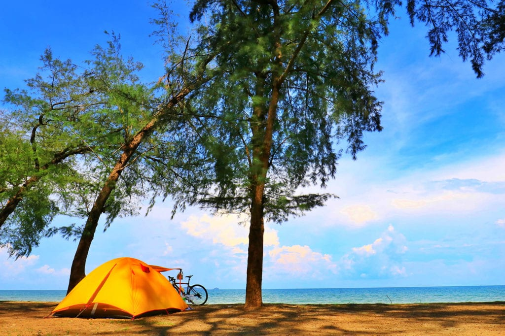 Small tent in hot summer weather near ocean Featured