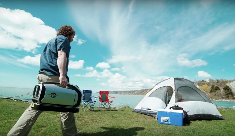 Zero-breeze-2-camper-walks-to-his-tent-during-day-to-start