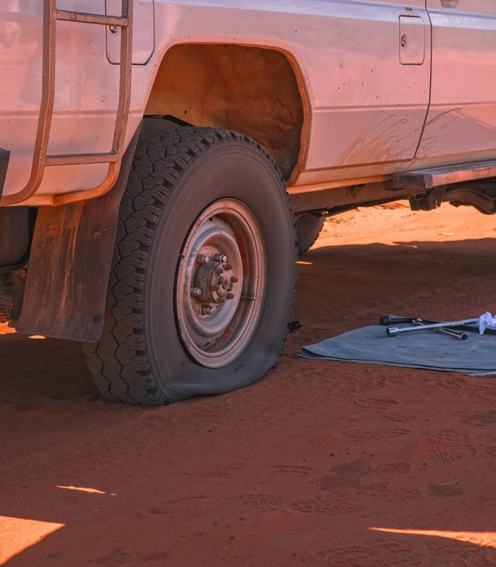 All wheel drive has flat tire in outback preparing to use Fix A Flat