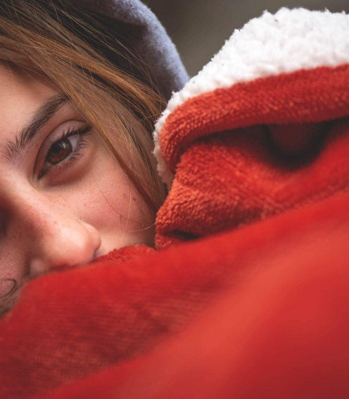 Female camper with red warm heating blanket