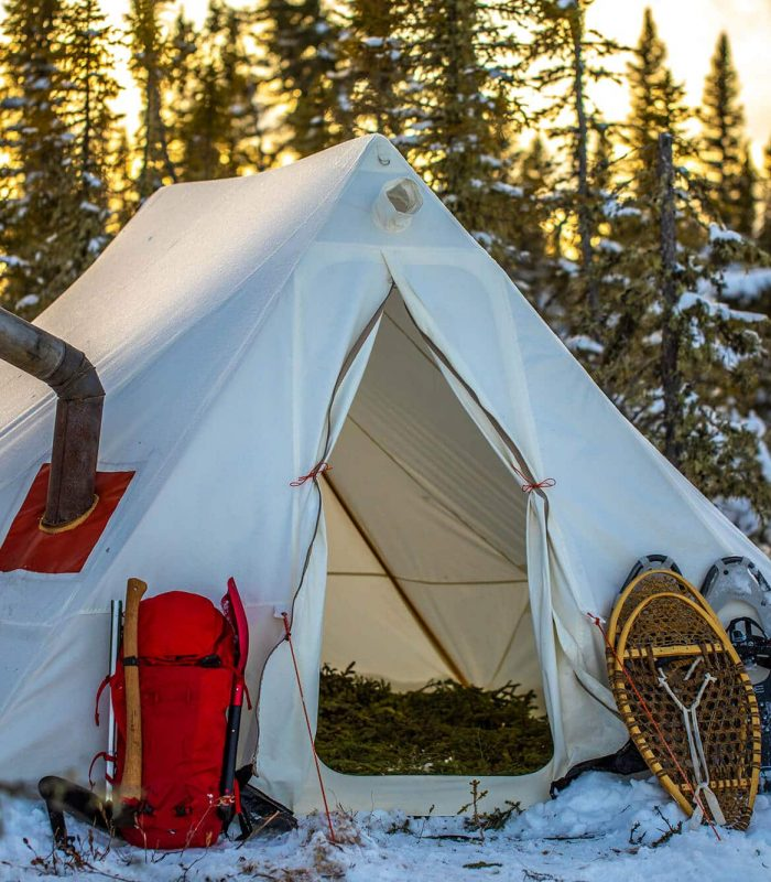 Tent with stove jack in the middle of freezing snow conditions