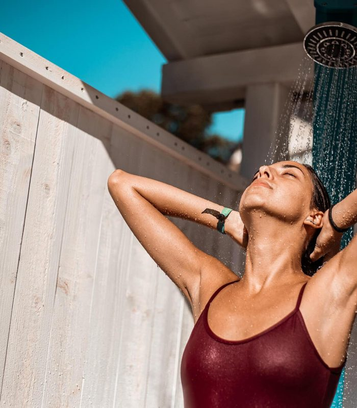 Woman washing hair outside in comfort with stitches